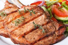 Grilled pork macro and salad with fresh vegetables Royalty Free Stock Photos