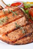 Grilled pork macro and salad with vegetables vertical Royalty Free Stock Photos