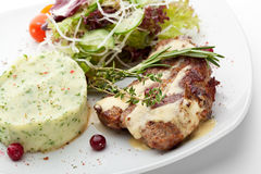 Grilled Pork. With Mashed Potato and Raw Vegetables Royalty Free Stock Image