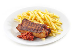 Grilled pork meat and french fries Royalty Free Stock Photography