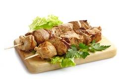 Grilled pork meat kebab Stock Photos