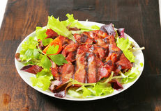 Grilled pork meat with salad greens Stock Photo