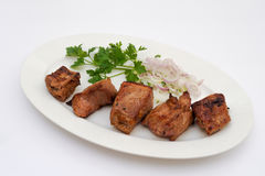 Grilled pork meat. Shashlik with onion rings and herbs Stock Photo
