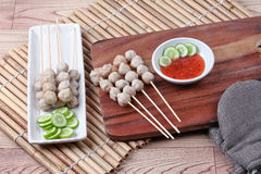 Grilled pork meatball skewers served cucumber and sweet chili sa Royalty Free Stock Image
