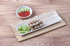 Grilled pork meatball skewers served cucumber and sweet chili sa Stock Photography