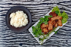Grilled pork with mixed herb served sticky rice . Stock Photo