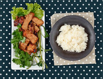 Grilled pork with mixed herb served sticky rice . Royalty Free Stock Photography