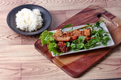 Grilled pork with mixed herb served sticky rice . Stock Photos