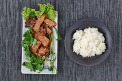 Grilled pork with mixed herb served sticky rice . Royalty Free Stock Photos