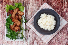 Grilled pork with mixed herb served sticky rice . Royalty Free Stock Image