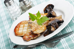 Grilled pork with mushrooms Stock Image