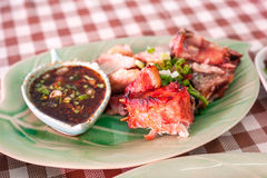 Grilled pork neck with dipping sauce in a northern Thai restaurant. Royalty Free Stock Photography