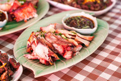 Grilled pork neck with dipping sauce in a northern Thai restaurant. royalty free stock photos