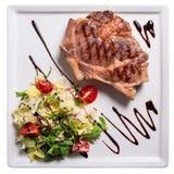 Grilled pork neck. Garnished salad Stock Photography