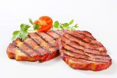 Grilled pork neck steaks Stock Photo