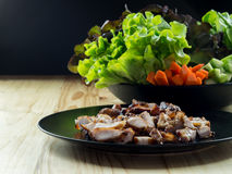 Grilled pork in a plate and Green leafy vegetables. Stock Image