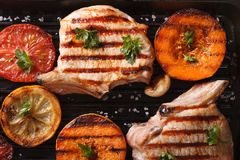 Grilled pork and pumpkin on a grill. top view horizontal macro Stock Photos