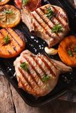 Grilled pork and pumpkin on a grill, Vertical top view macro Royalty Free Stock Photos