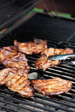 Grilled pork almost ready on the grill Stock Image