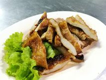 Grilled pork recipe served with fresh green lettuce. Asian grilled pork recipe served with fresh green lettuce Royalty Free Stock Photos
