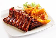 Grilled Pork Rib and Fried Potatoes on Plate Stock Photos
