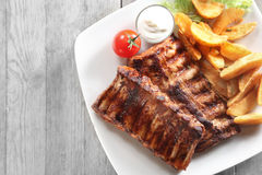 Grilled Pork Rib with Fried Potatoes on Plate Stock Photos