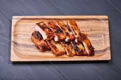 Grilled pork ribs. On wooden plate Royalty Free Stock Photo