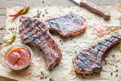 Grilled pork ribs on the baking paper. Close up Stock Photography