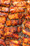 Grilled pork ribs on a baking sheet. Royalty Free Stock Photography