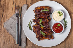 Grilled pork ribs in barbecue sauce. On white plate top view Stock Photography