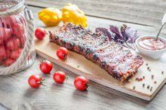 Grilled pork ribs in barbecue sauce Stock Image