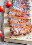Grilled pork ribs in barbecue sauce. On the wooden table Royalty Free Stock Photography
