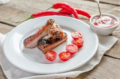 Grilled pork ribs in barbecue sauce Royalty Free Stock Images