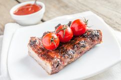 Grilled pork ribs in barbecue sauce Royalty Free Stock Photo