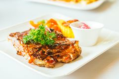 Grilled pork ribs with bbq sauce Royalty Free Stock Photo