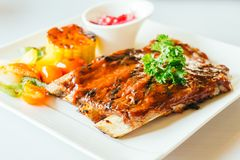Grilled pork ribs with bbq sauce. In white plate Stock Images