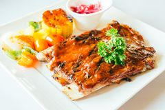 Grilled pork ribs with bbq sauce Royalty Free Stock Image