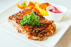 Grilled pork ribs with bbq sauce. In white plate Stock Photo