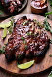 Grilled pork ribs. Bbq, grilled pork ribs on wooden board Royalty Free Stock Images