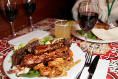 Grilled pork ribs, beef and shrimps Stock Photo