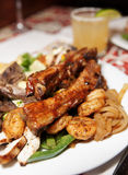 Grilled pork ribs, beef and shrimps Stock Photos