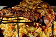 Grilled pork ribs with braised cabbage on a baking sheet. stock photo