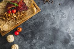 Grilled pork ribs, buckwheat with mushroom and tomatoes on vintage wooden cutting board. Flat lay, top view. Food frame, copy spac. Grilled pork ribs, buckwheat Stock Photo