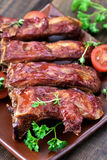 Grilled pork ribs on ceramic plate Royalty Free Stock Photos