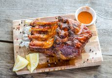 Grilled pork ribs. On the cutting board Royalty Free Stock Images