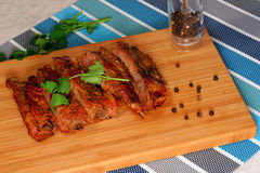 Grilled pork ribs. On a cutting board.black pepper and coriander Royalty Free Stock Images