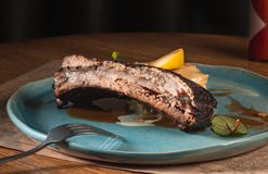 Grilled pork ribs on dark plate Royalty Free Stock Photos