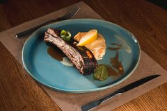 Grilled pork ribs on dark plate Royalty Free Stock Photo