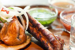 Grilled pork ribs with different sauces close up Royalty Free Stock Image