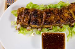 Grilled Pork Ribs with Dipping Sauce on Plate Stock Photography